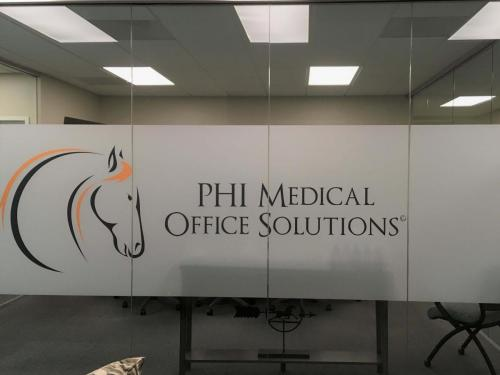 PHI logo on outside of Boardroom